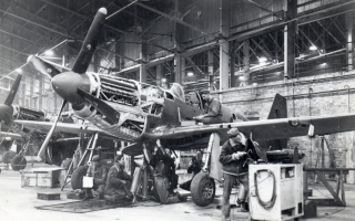 USAAF Personnel work on an RAF P-51 Mustang in BAD-2's 5 hangar.